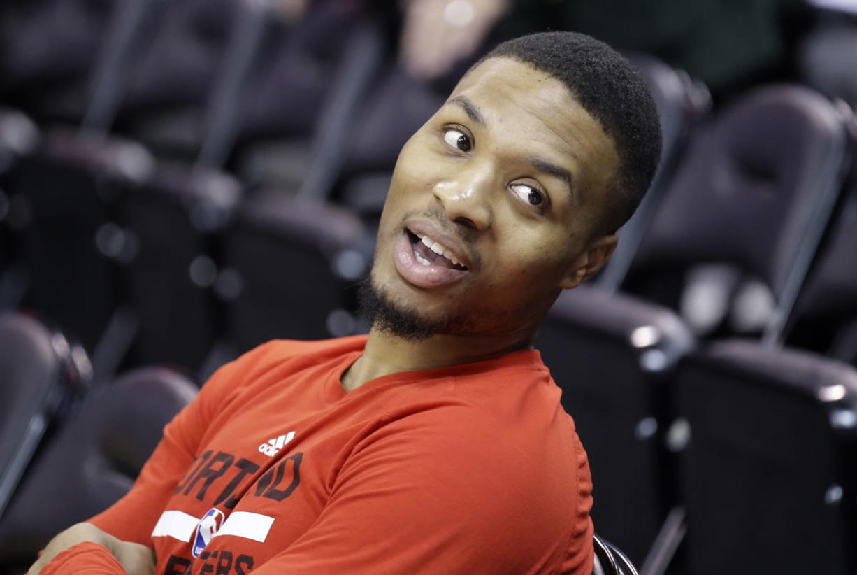 Portland Trail Blazers guard Damian Lillard (0) looks on during practice before the start of their NBA basketball game against the Utah Jazz Thursday, Dec. 31, 2015, in Salt Lake City.