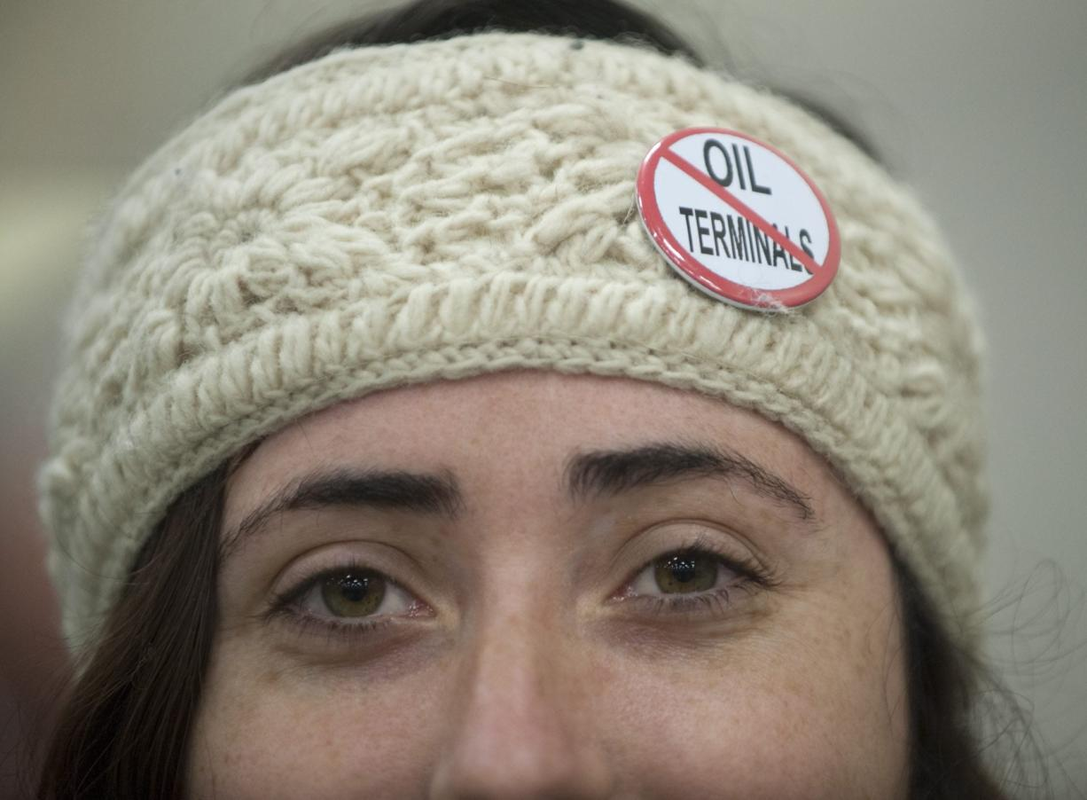 Erin Murdock wears a button indicating her opposition to building an oil transfer terminal, at the first public hearing on the matter Jan. 5 in Vancouver.