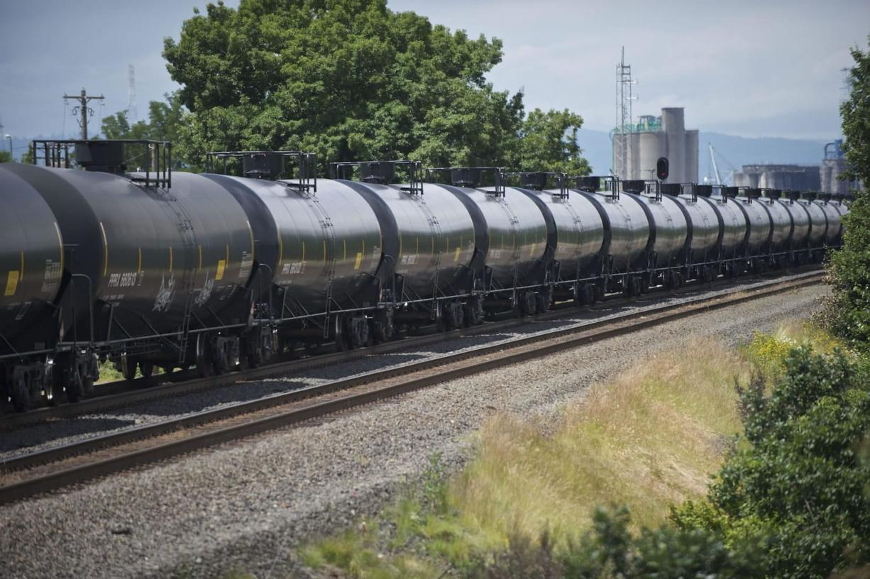An oil train passes the Vancouver Land Bridge in June 2014. (Zachary Kaufman/The Columbian)