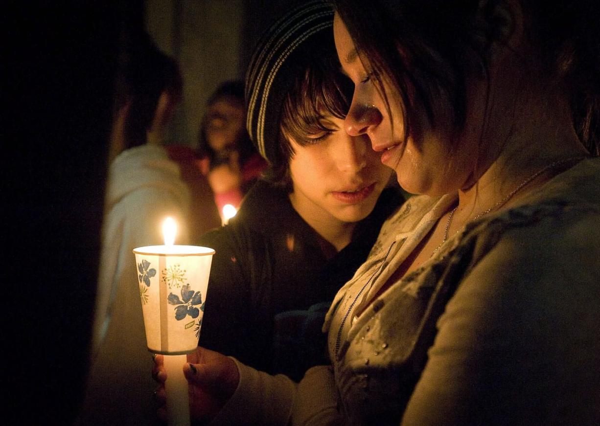 Ryan Newman, left, comforts Vivi Nikolaychuk during a candlelight vigil for their friend Eden Van Horn at Cascade Middle School. Nearly 200 teens gathered to mourn their friend.