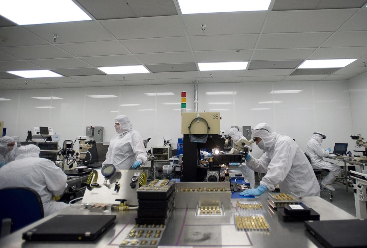 Workers bustle at nLight's Vancouver bonding lab.