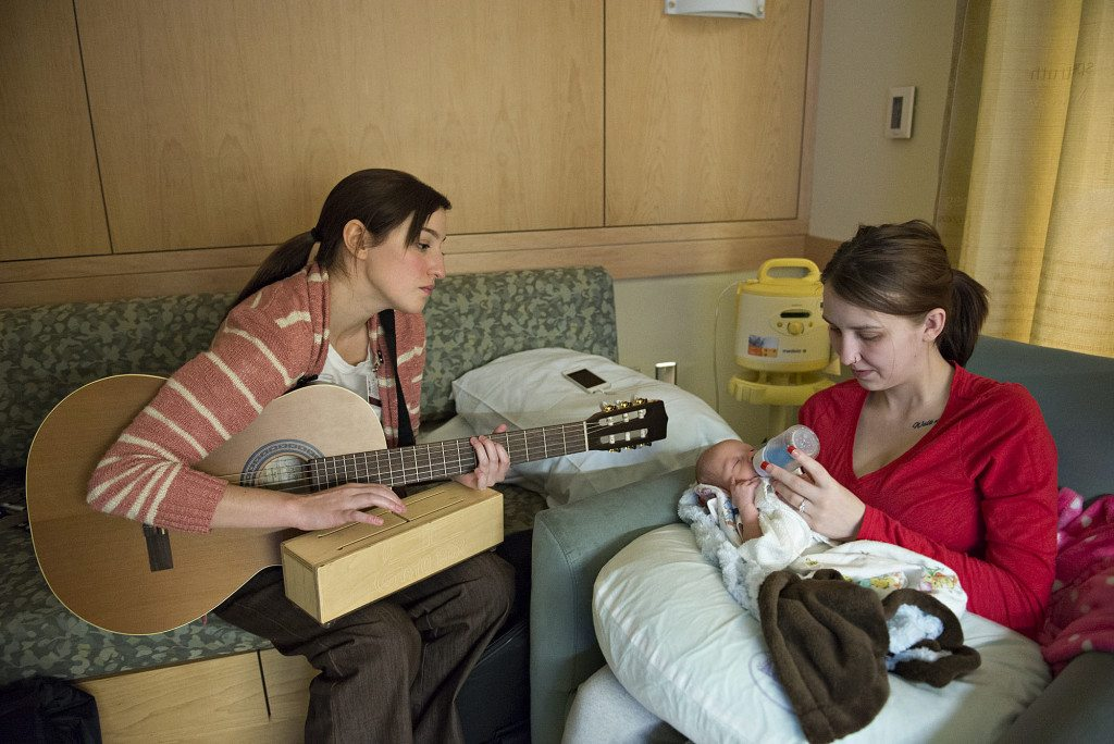 Music Therapist Susan Palmieri Left Taps On A Gato Box Instrument As Haley Giese
