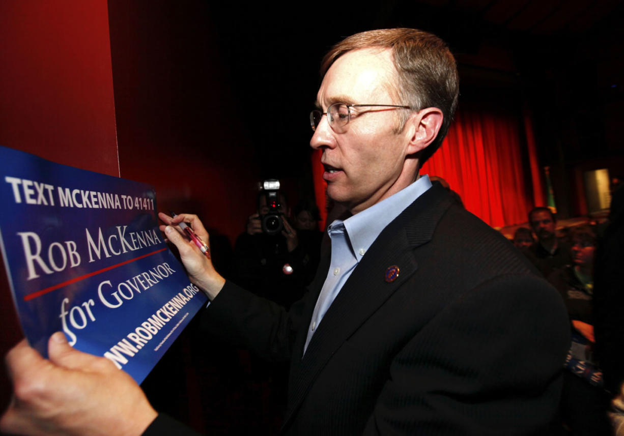 State Attorney General Rob McKenna autographs a campaign sign after addressing supporters at Sammamish High School Wednesday in Bellevue. McKenna announced that he will be running for governor for the 2012 election.