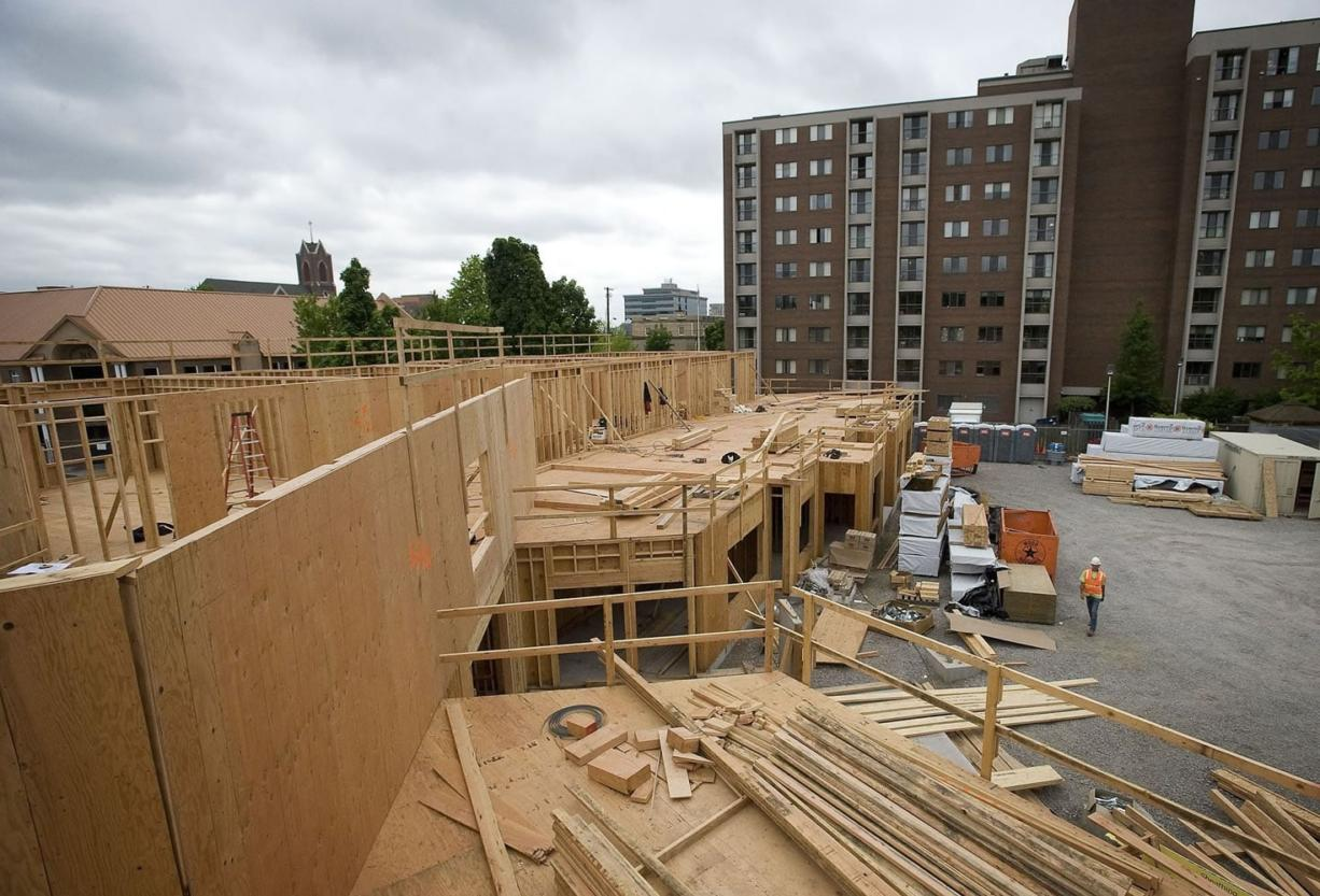 Construction crews work on Vista Court, a 76-unit residential project for seniors being developed by the Vancouver Housing Authority. The project was designed to complement the nearby 100-unit Van Vista complex, at right.