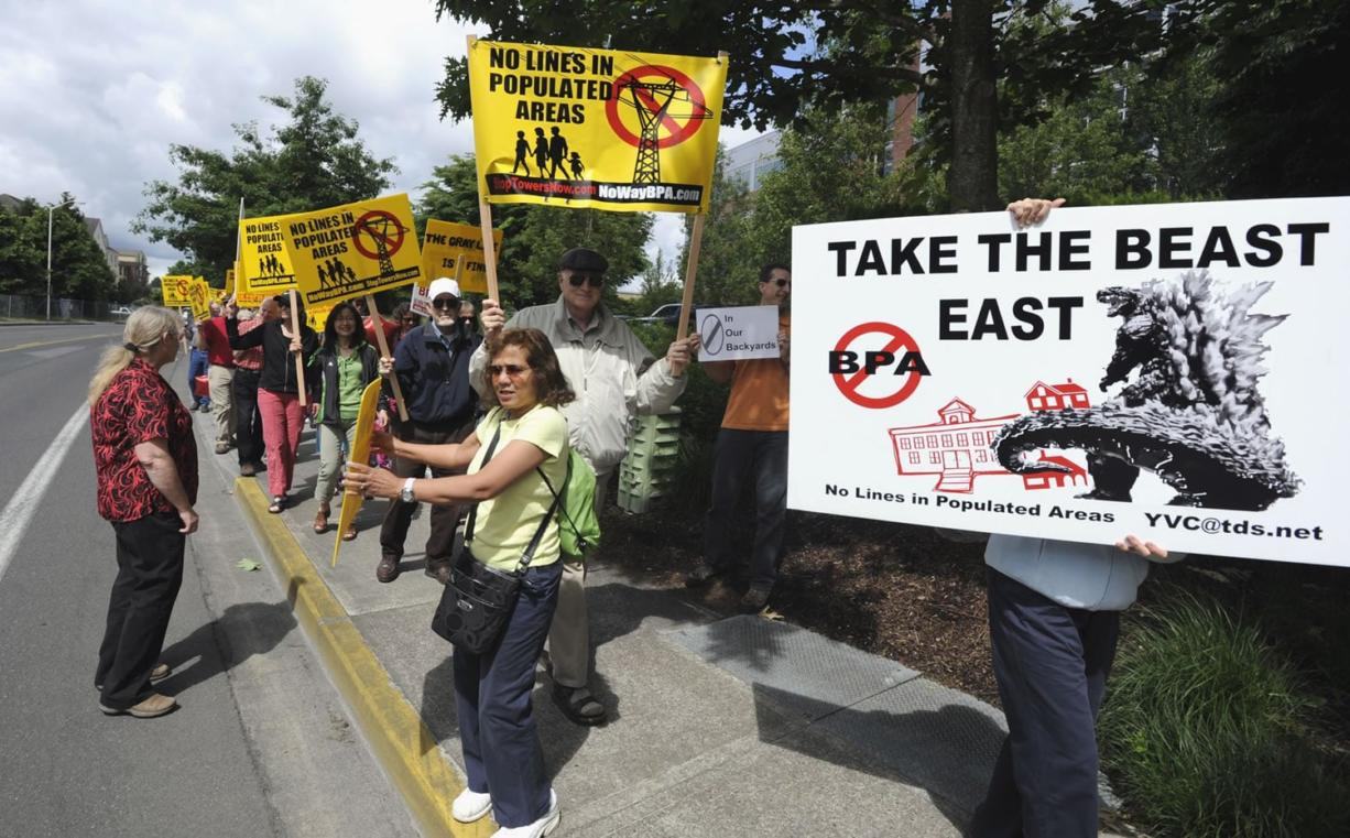 More than 100 protesters marched outside the Bonneville Power Administration offices in Vancouver Friday to demand that the BPA choose a route for a new transmission line that won't run through neighborhoods in Clark and Cowlitz counties.