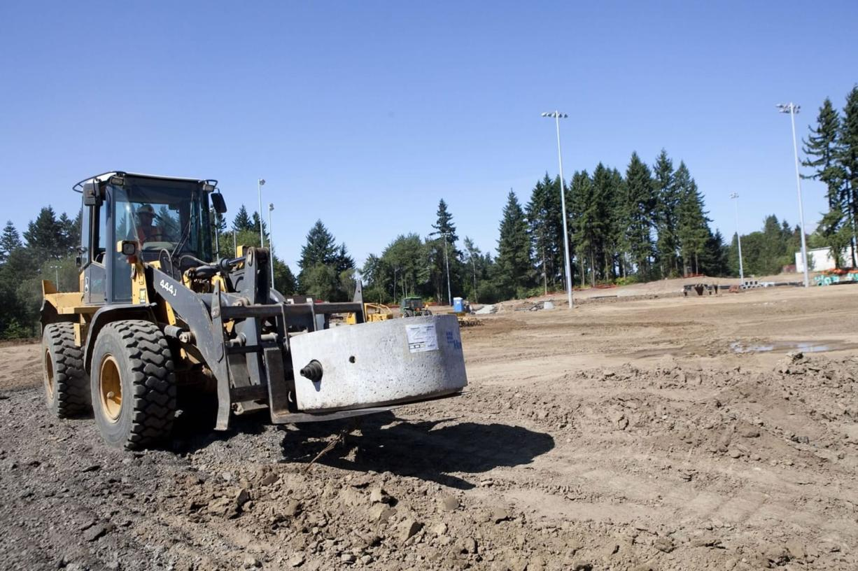 Construction on Luke Jensen Sports Park is under way, as a piece of the storm water drain system is moved into place. When finished, two of the park's fields will feature synthetic turf that will keep fields playable through wet weather.