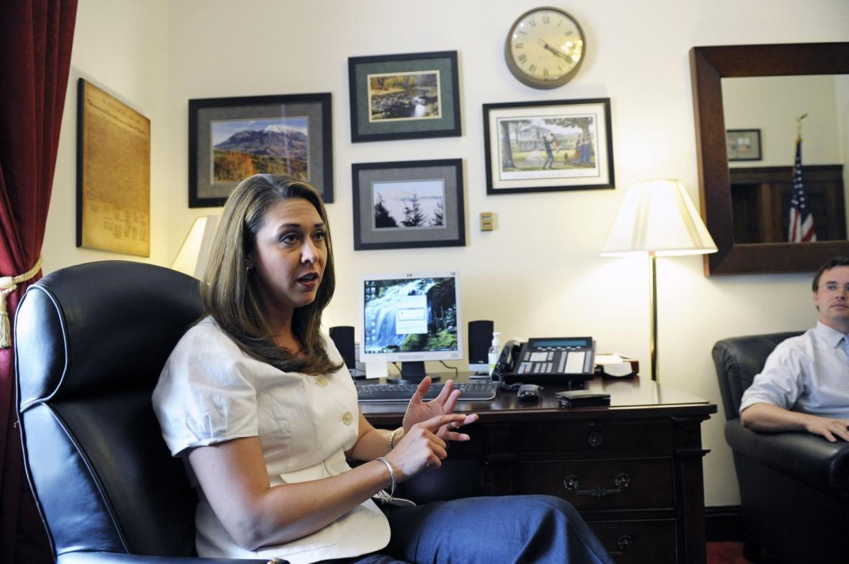 Rep. Jaime Herrera Beutler, R-Camas, meets with her legislative and communications staff in her Capitol Hill office in Washington, D.C., on Monday, the day she cast her vote to raise the nation's debt limit and cut federal spending.