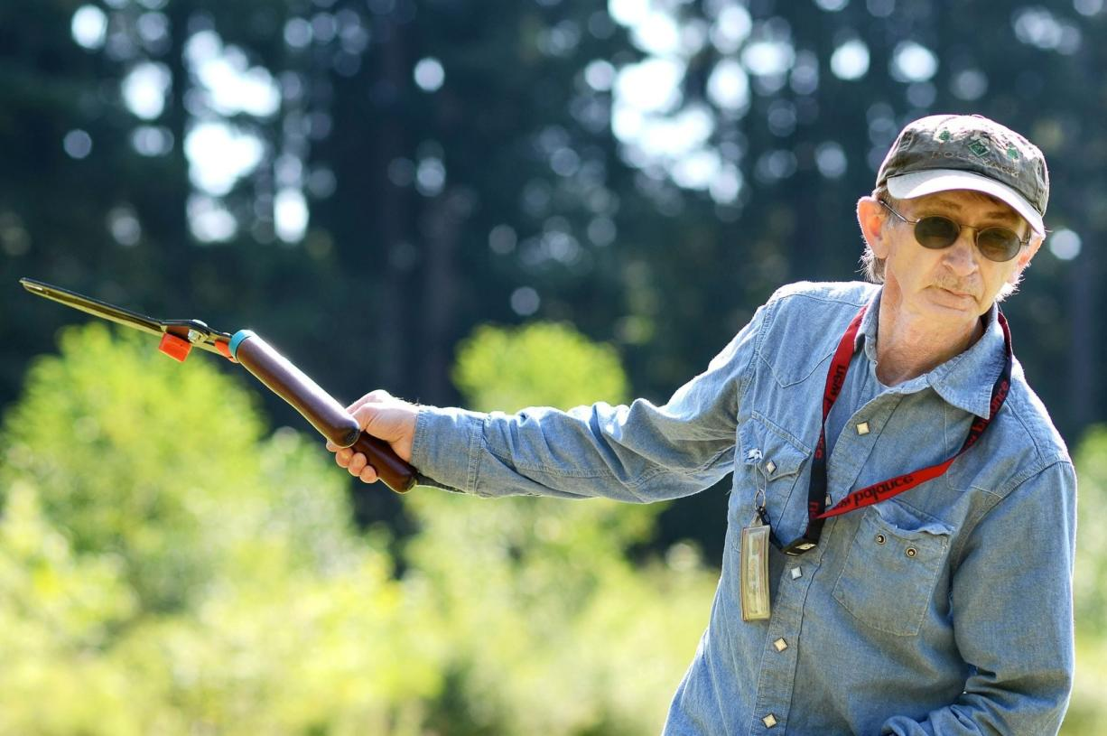 Terrance Olson, 62, a facilities worker for Washington State University Vancouver, points out some of the places where he has been removing blackberry bushes in the Mill Creek area, east of campus, this month.