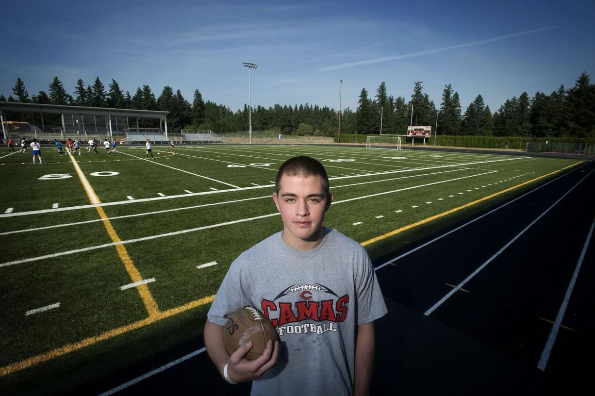 Former Camas football player Ikaika Gunderson had plans to play college ball at Southern Oregon University, but has been sidelined with post concussion symptoms.