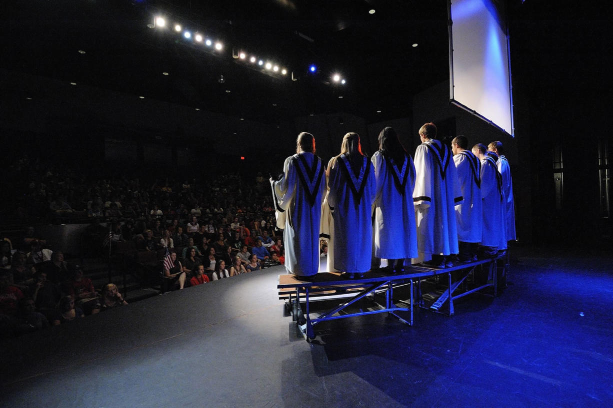 """Washougal High School's chamber choir sings """"Set me as a seal"""" during one of the school's two assemblies Friday morning. The program, with music, poetry and a video showing iconic images from Sept."""