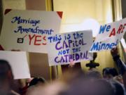 On this May 19, 2011 file photo, demonstrators on both sides of the gay marriage issue gathered outside the Minnesota House in St. Paul, Minn. The Census Bureau reports there are 131,729 same-sex couples in the U.S. who say they're married _ the first-ever government count of this kind.