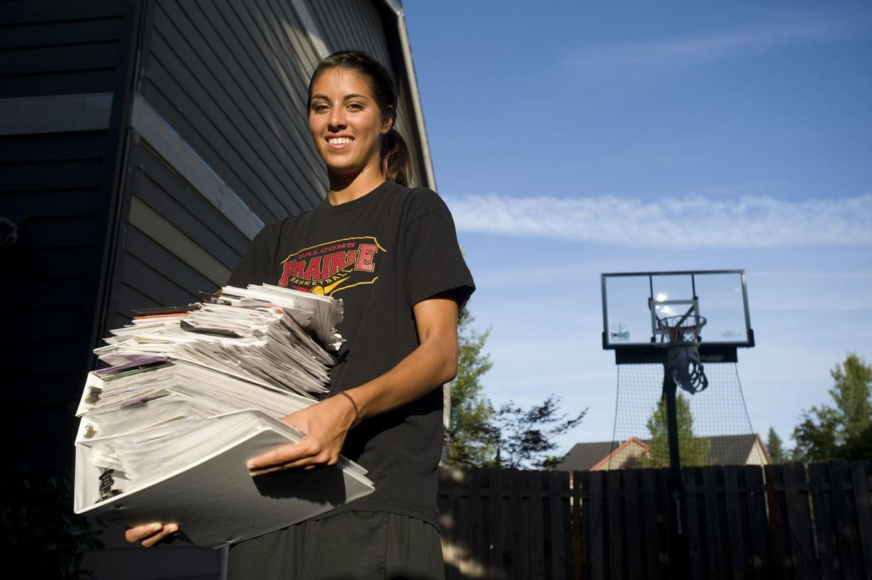 Heather Corral holds a stack of college information from her recruitment process. The Prairie senior announced Monday she will attend Washington.