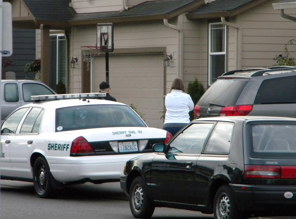 Police are pictured here responding to the Battle Ground home of Clark County sheriff's Detective Ed Owens on Sept. 15, 2010, a day after an accidental shooting there. Owens' 3-year-old son, Ryan, got ahold of his father's gun, accidentally shooting himself.