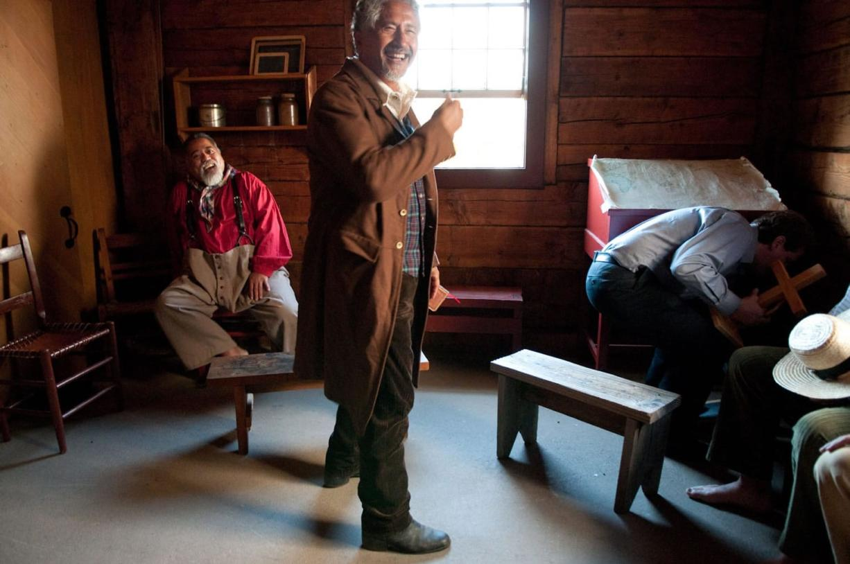 Actors Frank van Waardenburg, center, and Bullie Magsayo, left, enjoy a lighter moment between takes while filming a church scene at Fort Vancouver.