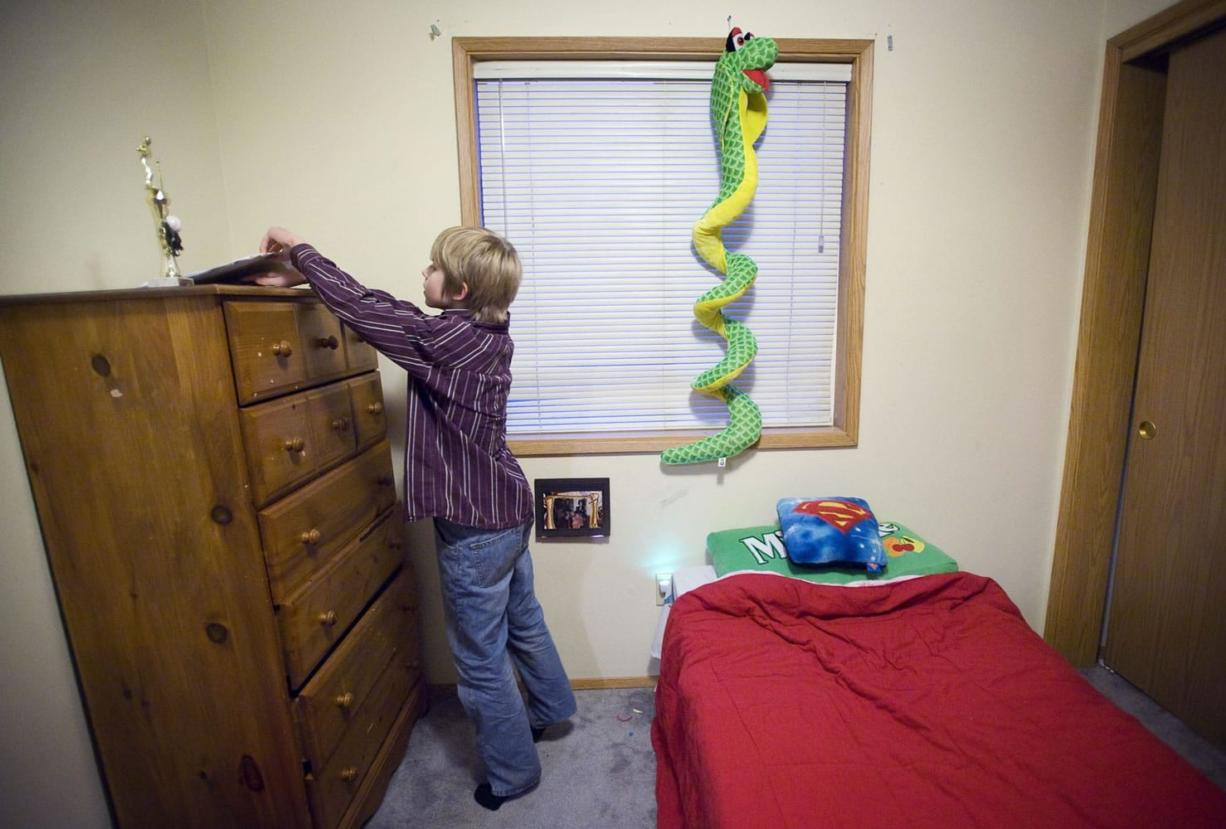 Darian Sund, 9, searches for a pencil in his bedroom so he can draw at his home in Walnut Grove.