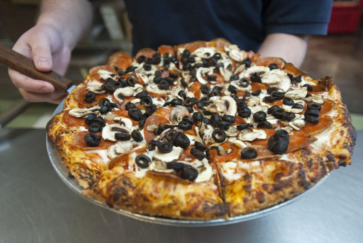 A Pepperoni Plus pizza is served Jan. 7 at Bellagios Pizza in east Vancouver. (Natalie Behring/The Columbian)