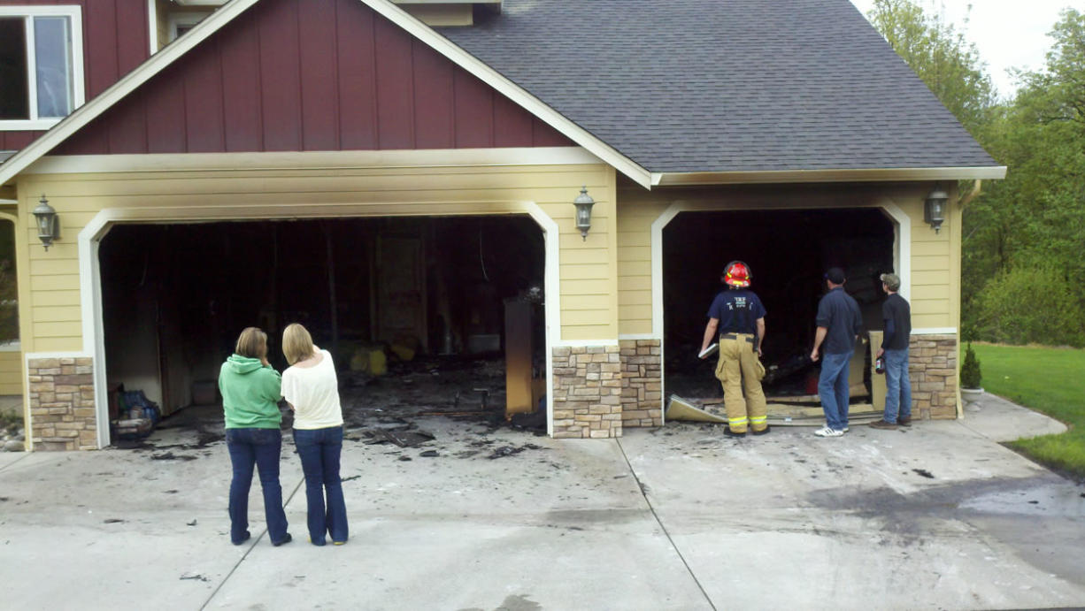 A garage fire did about $30,000 damage to this Ridgefield-area house on Sunday but a sprinkler system kept it from causing much more damage, said Battalion Chief Tim Dawdy of Clark County Fire & Rescue.