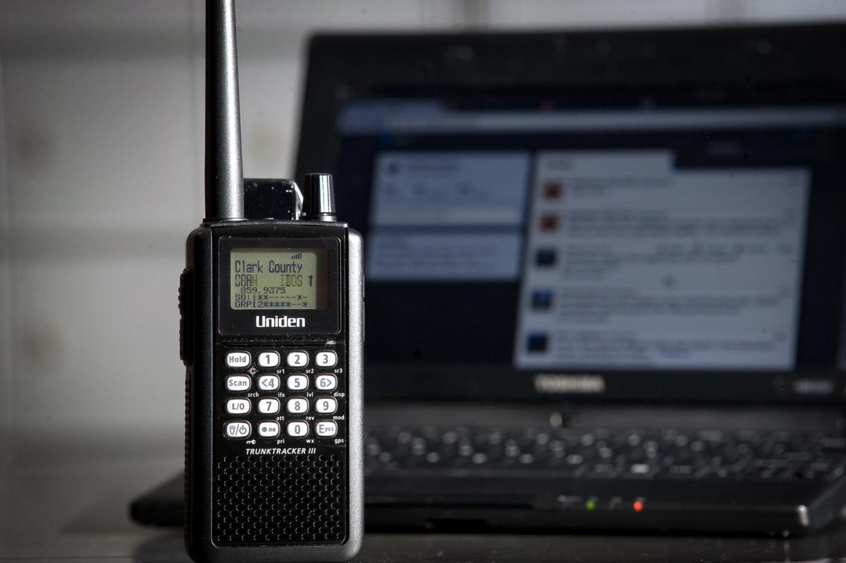 Jason Williard's gear includes a handheld scanner and laptop computer.