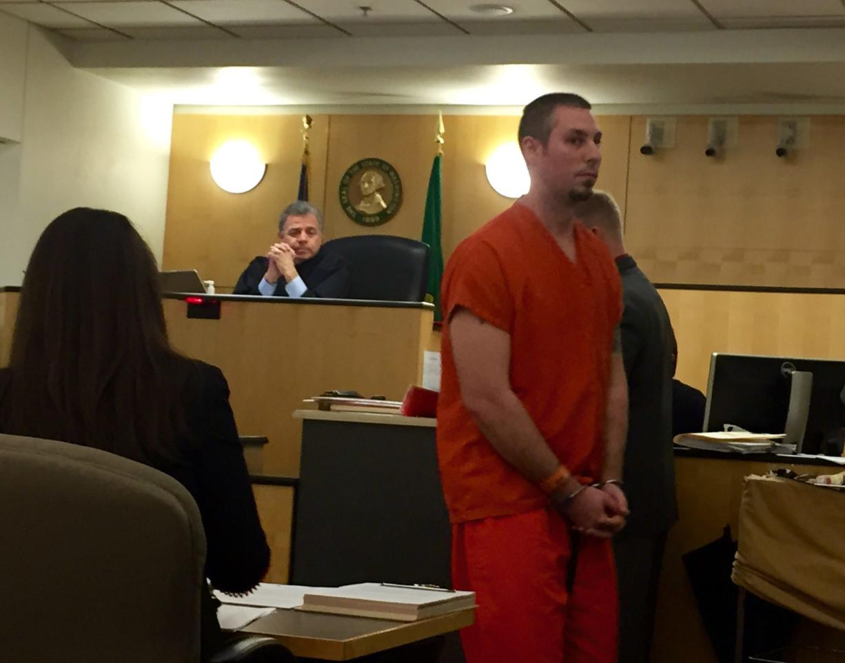 Alex J. Wright, 30, makes a first appearance Friday in Clark County Superior Court on suspicion of 18 counts related to child pornography. Wright has been an employee with Vancouver Public Schools since 2010.