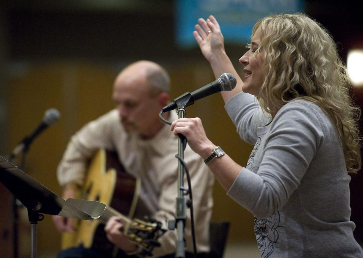 Becky Manuel leads the worship portion of a 30-plus singles group at Crossroads Community Church.