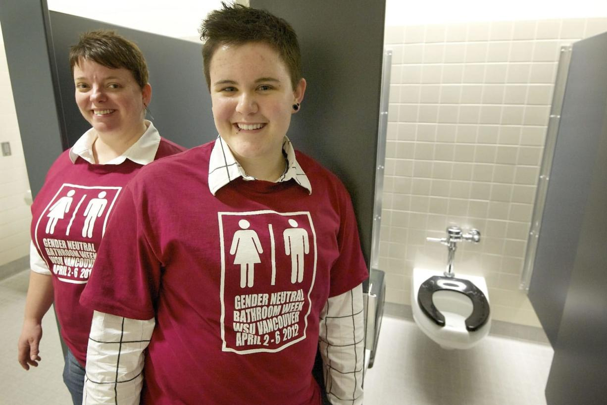 Meredith Williams, left, and Janae Teal have organized a weeklong restroom campaign at Washington State University Vancouver, after Teal frequently was harassed in women's restrooms on campus. Since the campaign started, many other students have shared stories of similar harassment.