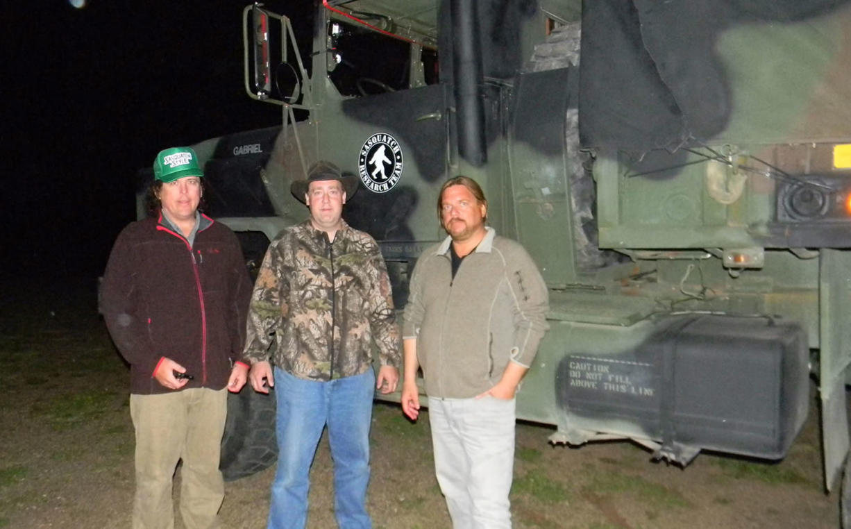 "Joe Bongiovanni, middle, of Kalama, James ""Bobo"" Fay, left, field researcher with Bigfoot Field Researchers Organization, and Matt Moneymaker, the organization's founder, team up to search for Bigfoot."