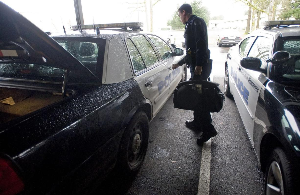 Vancouver police officer Ken Suvada prepares a patrol vehicle at Vancouver Police Department's West Precinct for his swing shift.