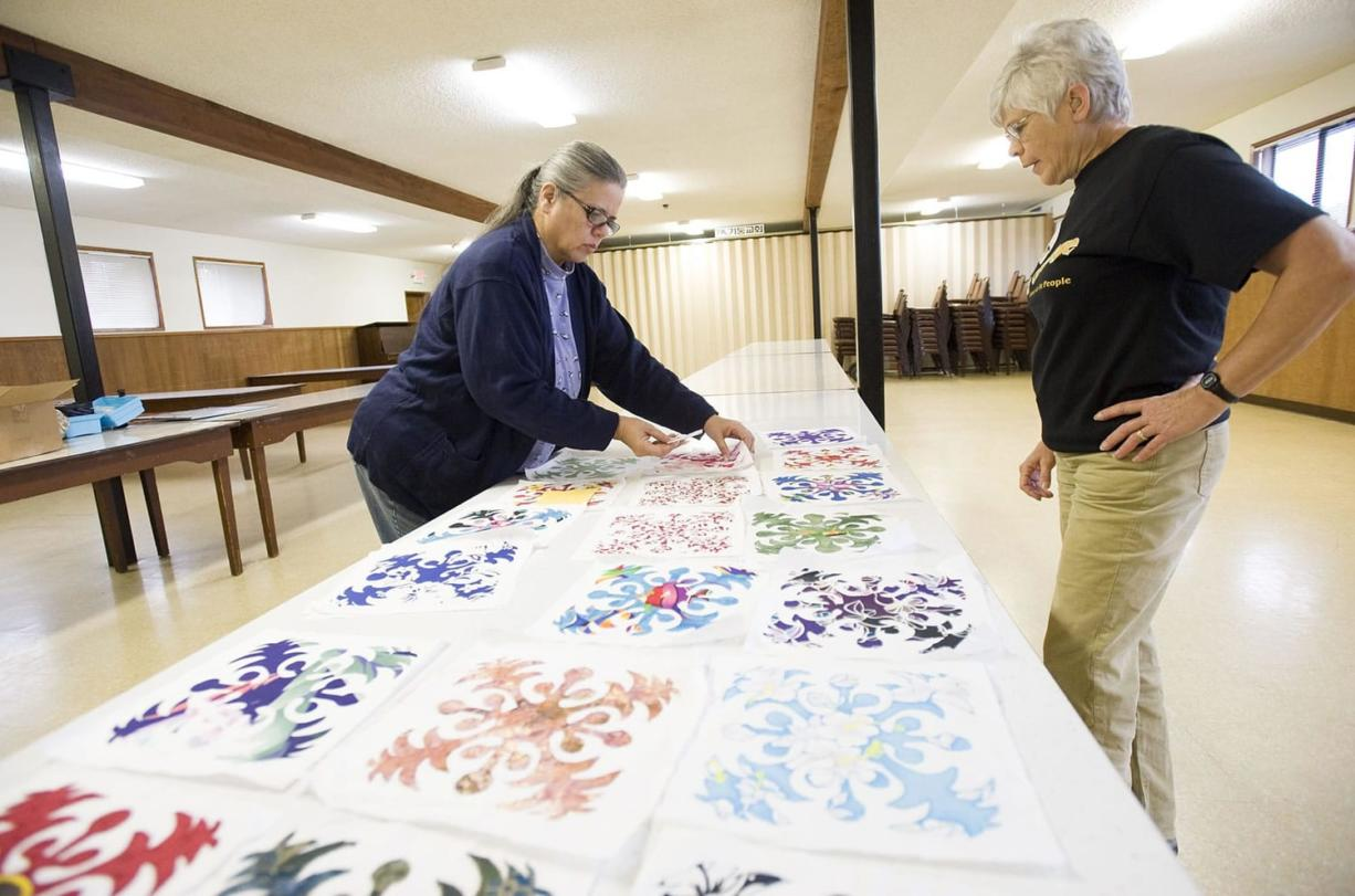 Mary Myers, 62, from Camas, left, and Toni Kapitanovich, 65, from Battle Ground, plan a quilting project at the Washington Grange No.