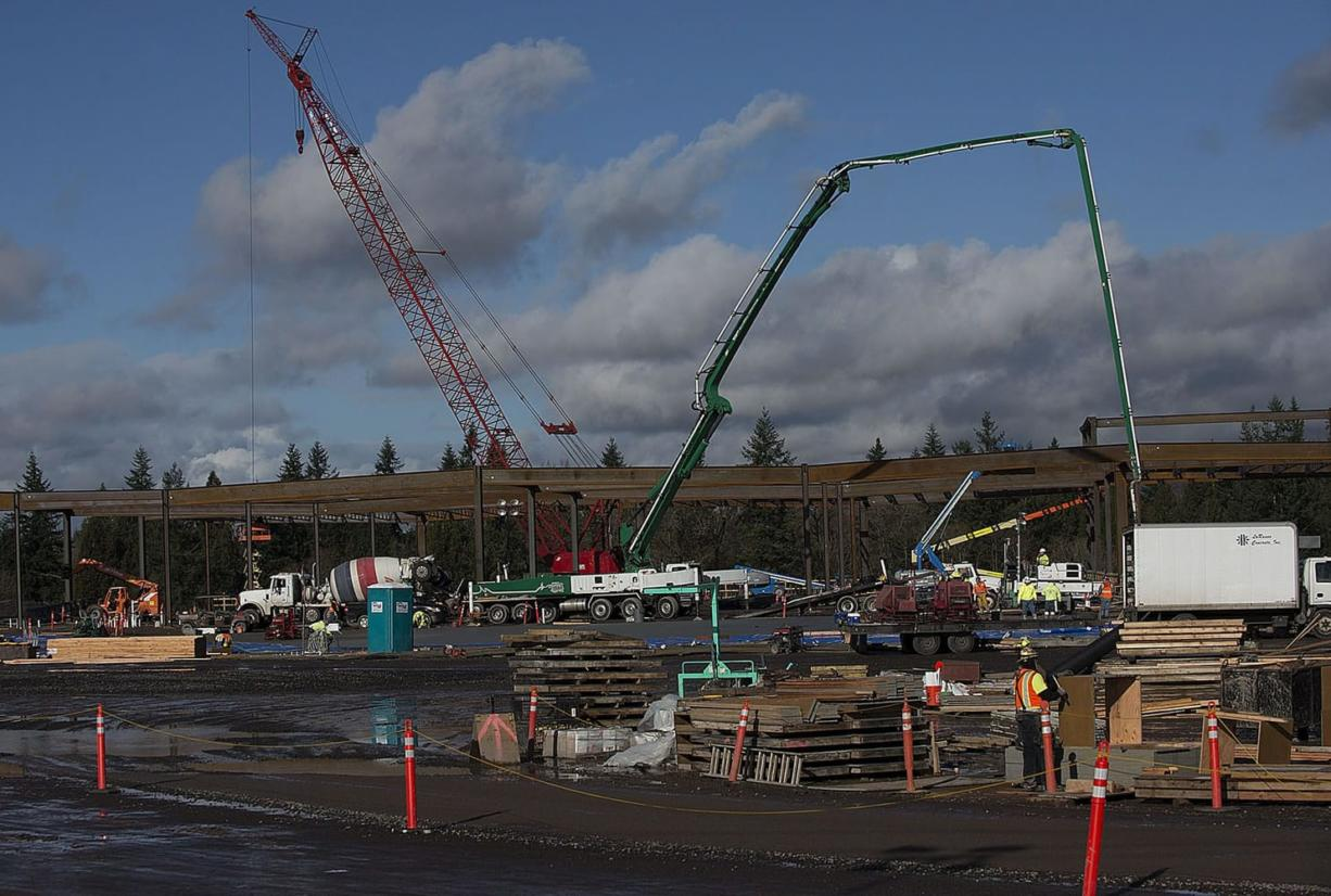 The Cowlitz Indian Tribe's $510 million casino-resort is beginning to rise near La Center along Interstate 5 at Exit 16. Roughly 110 workers are on the site, working on the basement and erecting steel girders, project manager Pete Schultz said Thursday.