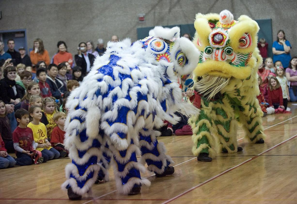 Portland Lee's Association Lion Dance Team performs during a program to celebrate the Chinese New Year at Ben Franklin Elementary School on Friday.
