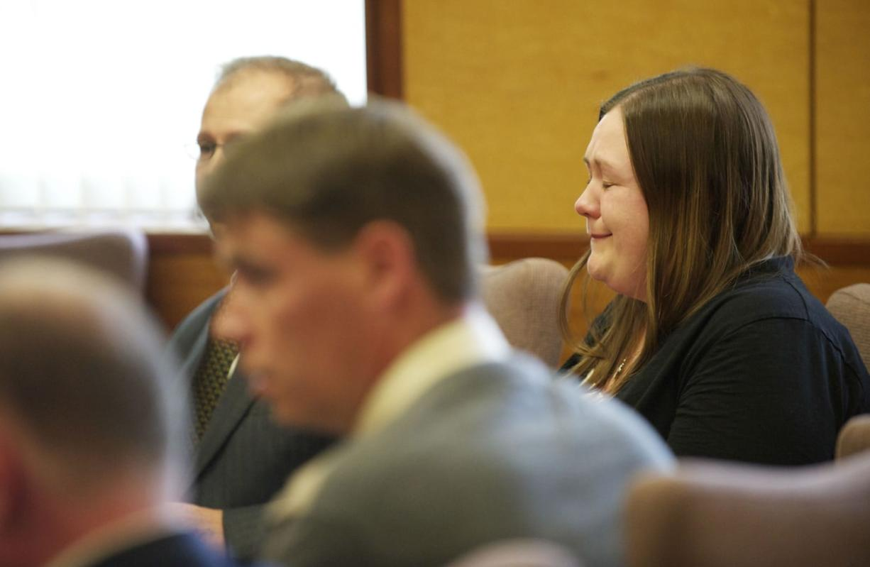 Alayna Higdon reacts Tuesday when a Clark County jury acquitted her and John Eckhart of unlawful imprisonment in connection with their practice of locking Eckhart's two autistic sons in a bedroom secured with a cage-like door.