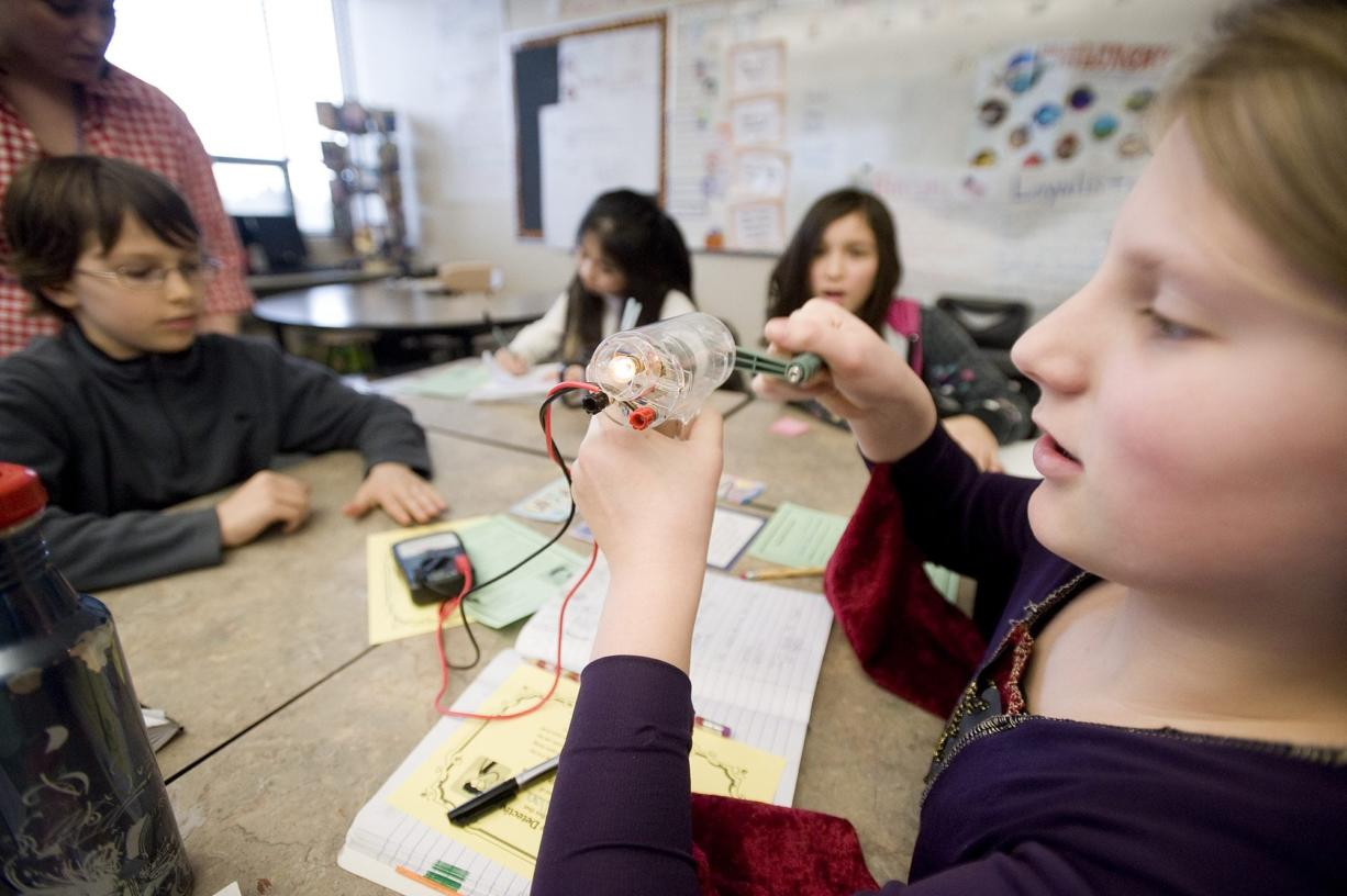 Hannah Callan, 10, a fifth-grader at Columbia Valley Elementary School, cranks her own electricity Tuesday.