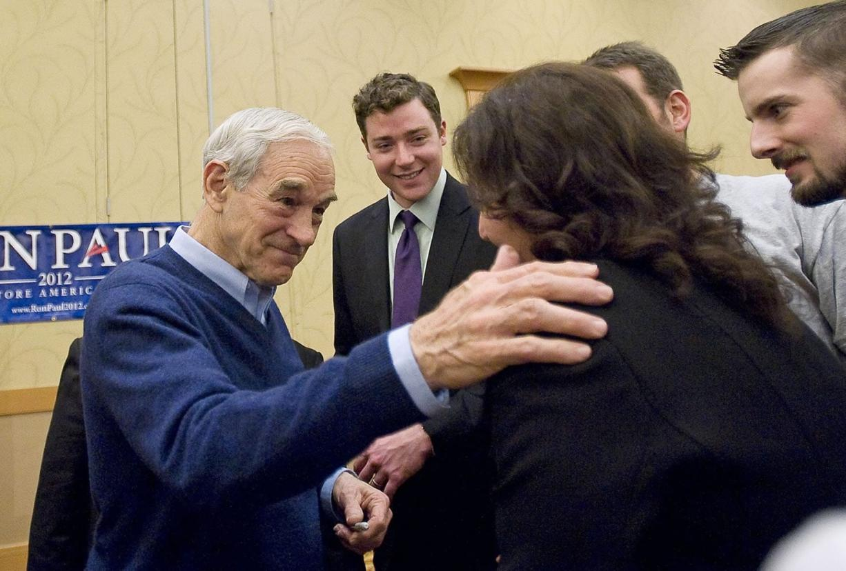 Republican presidential candidate Ron Paul meets supporters after speaking during a rally at the Hilton Vancouver Washington.