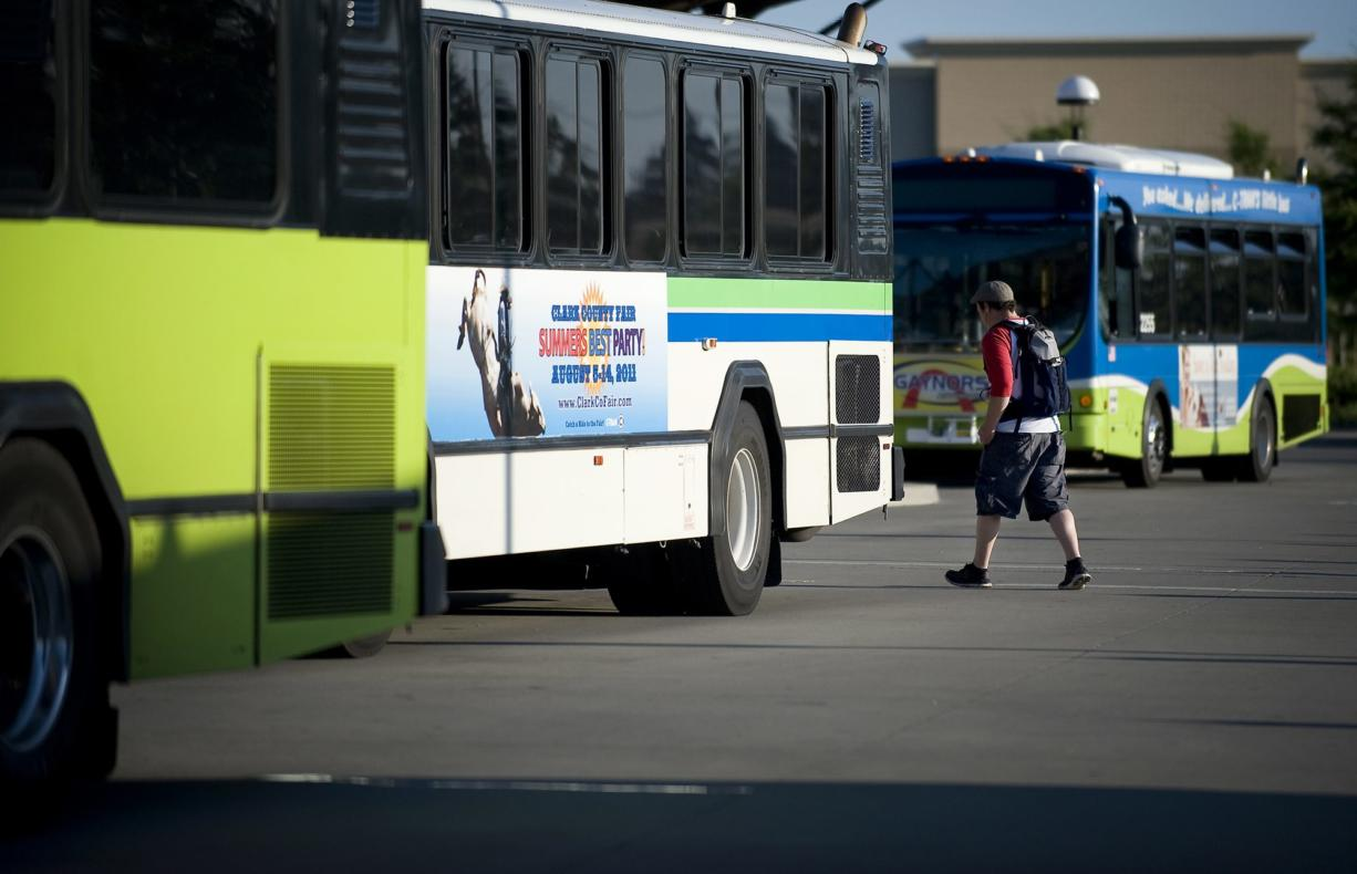 A passenger prepares to board a bus July 28 at the 99th Street Transit Center.