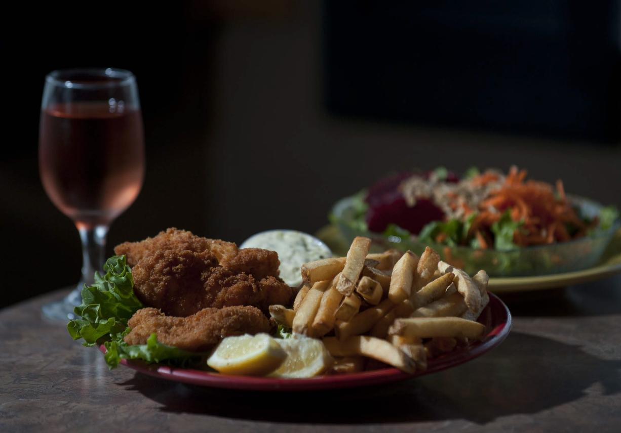 Fish and chips and a green salad are offered at Julie's Cottage Kitchen on Northeast 72nd Avenue.