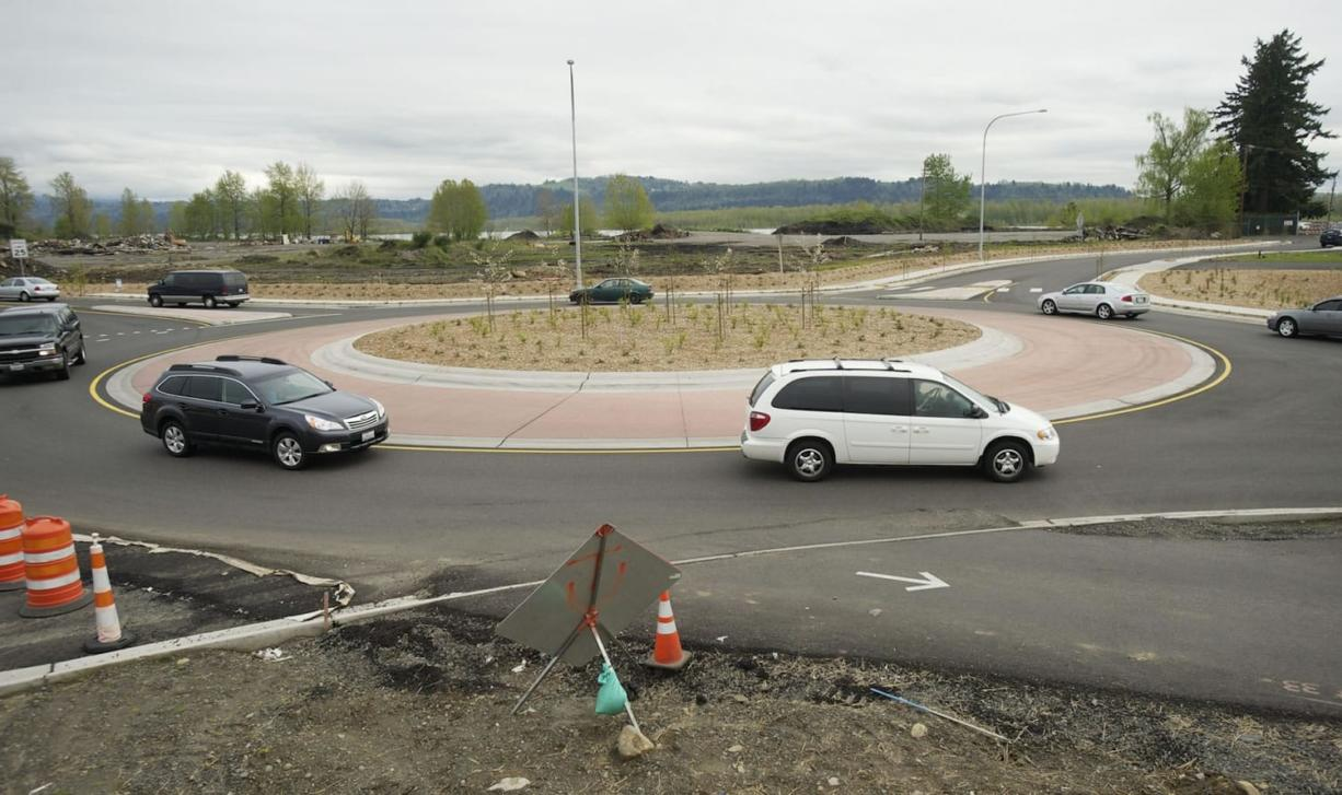 Cars navigate one of the new roundabouts that are part of the Highway 14 widening project in Camas and Washougal.