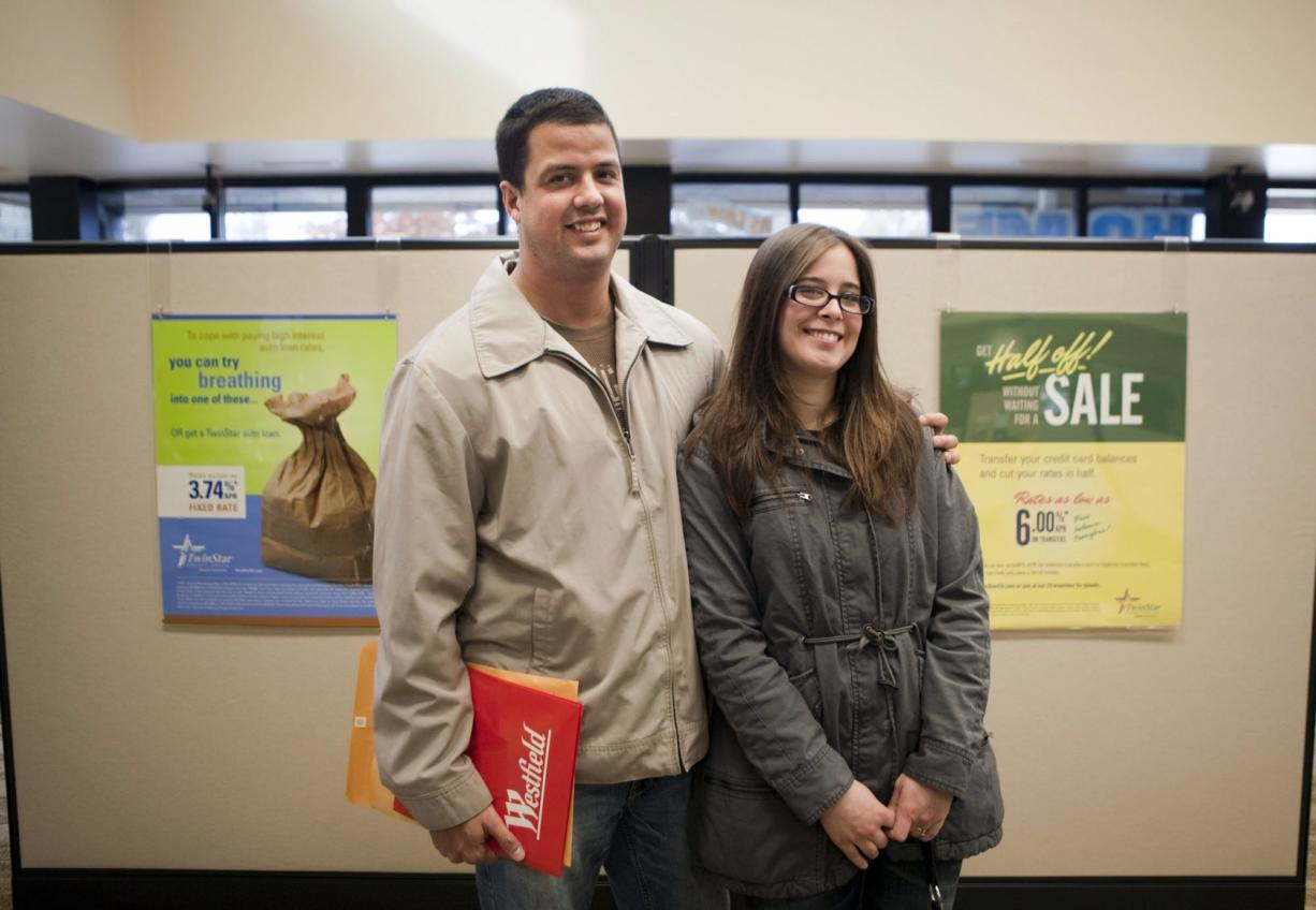 Alyssa and David Paulson of Vancouver visit a Twinstar Credit Union branch where they opened a business account Saturday.