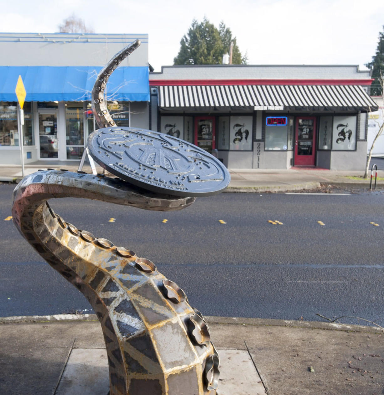 "Vancouver's newest piece of public art, ""The Visitor,"" busts out of a manhole at West 23rd Street and Main."