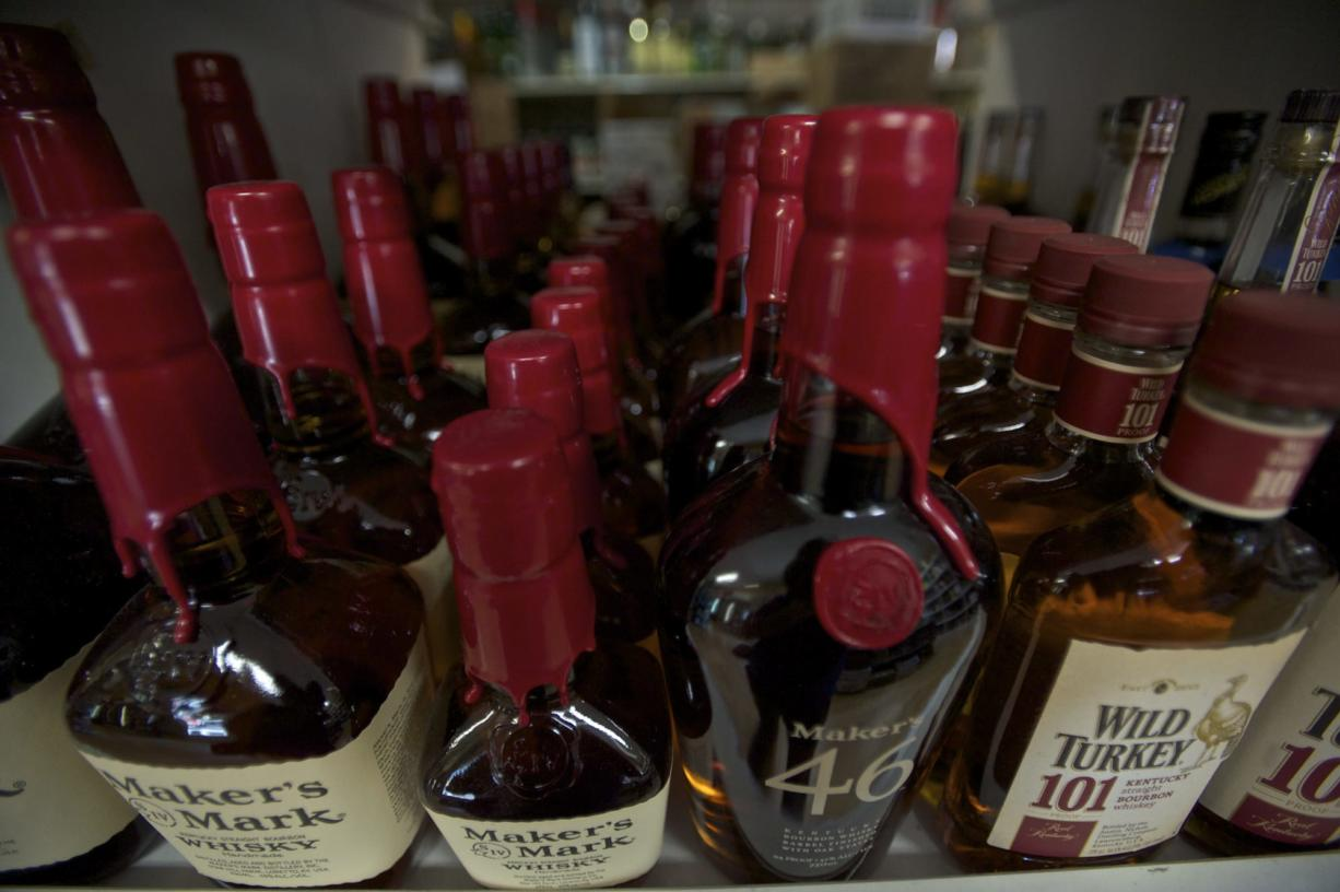 Whiskey bottles sit on a shelf inside the Ridgefield Liquor Store owned by Scott Hughes on Monday.