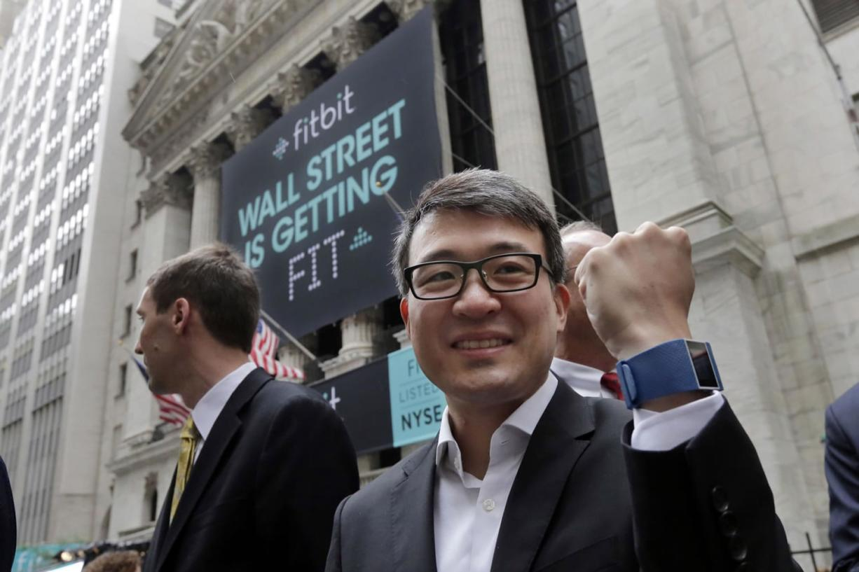 Fitbit CEO James Park shows off one of his devices on June 18 outside the New York Stock Exchange, before his company's IPO. The company's app was the most downloaded on Apple's app store on Christmas Day.