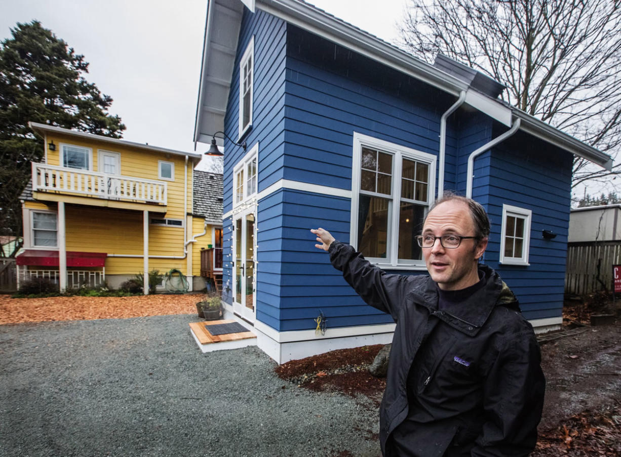 Matt Stevenson says a city parking-spot requirement added to high construction costs for the backyard cottage he and his wife will rent out in Seattle.