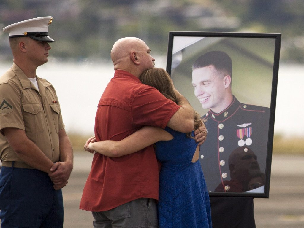 Flight Gear Adorns Crosses At Service For 12 Marines Killed In Helicopter Crash