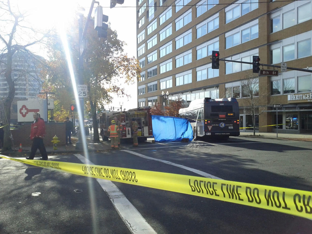 Rescuers are working to extract the victim from under a C-Tran bus at 8th and Washington Streets in Vancouver.