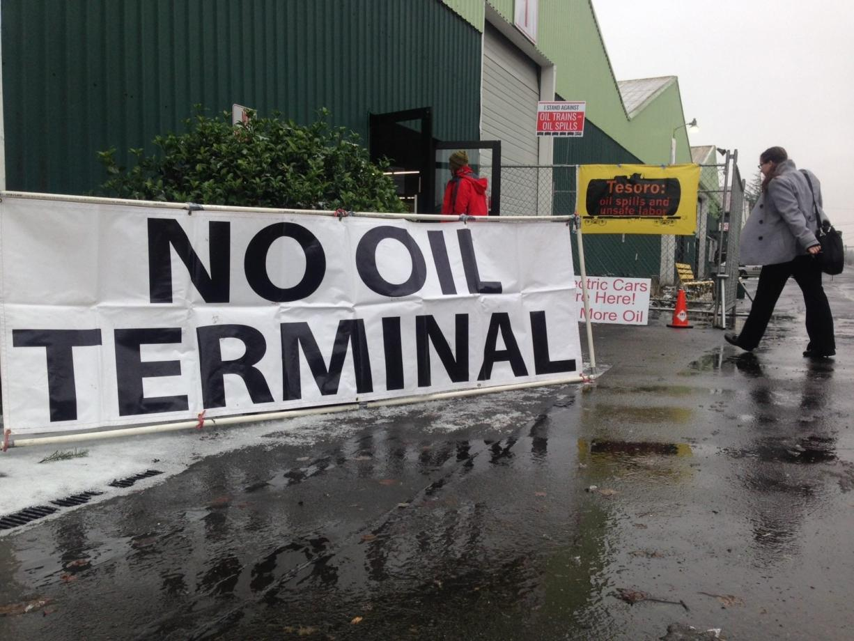 Protesters gather at the Clark County Event Center at the Fairgrounds in Ridgefield before a hearing on the proposed oil terminal at the Port of Vancouver.
