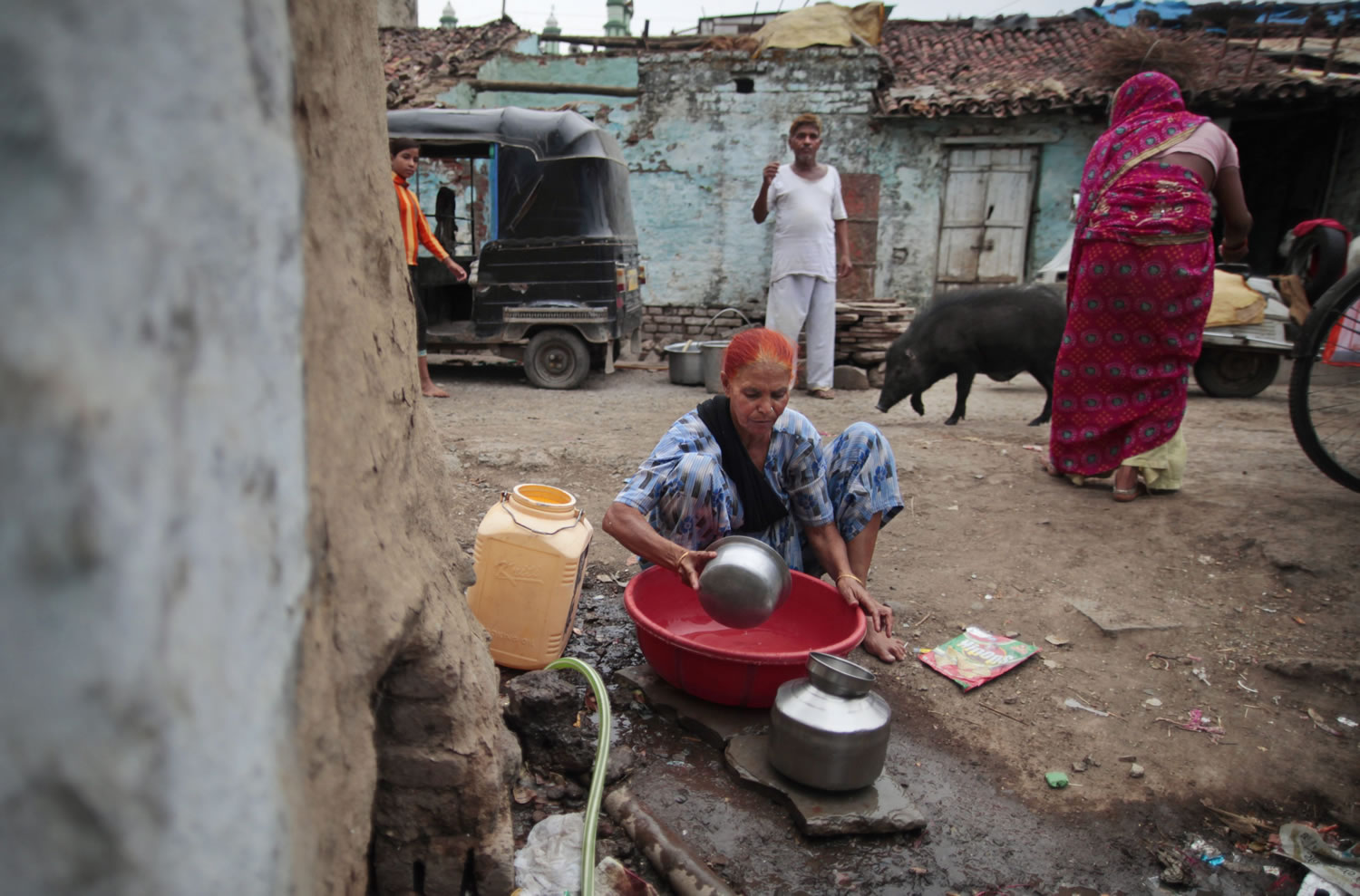 In this May 10, 2012 photo, Fatima Munshi collects water for domestic consumption from a community faucet outside her home in Khandwa, India. Living in Australia, Saroo Brierley, 30, was reunited with his biological mother, Munshi, in February 2012, 25 years after an ill-fated train ride left him an orphan on the streets of Calcutta.