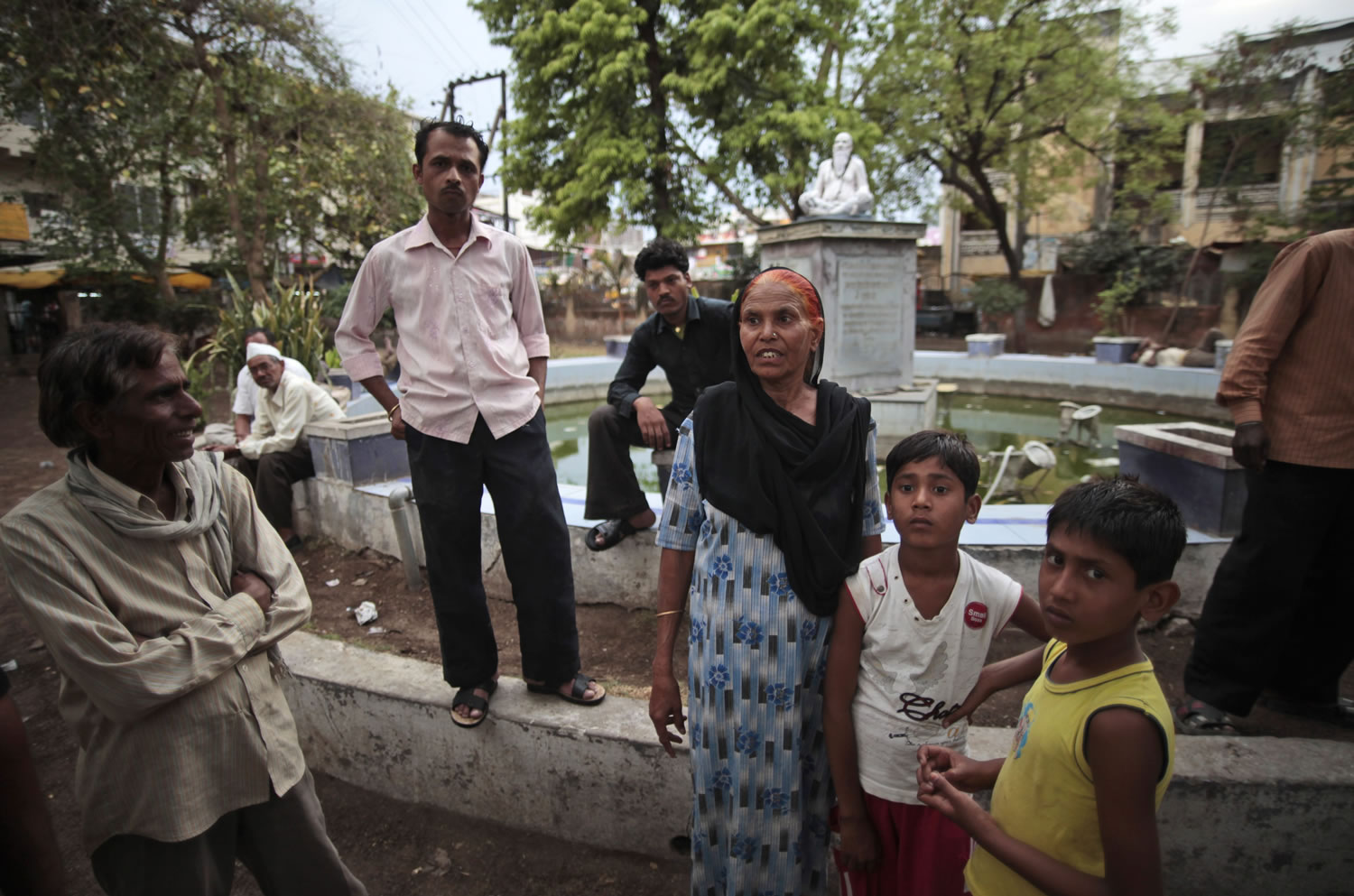 In this May 10, 2012 photo, Fatima Munshi, center, shows the fountain in Khandwa, India where her sons Saroo and Guddu played as she worked as a daily wage laborer about 25 years ago. Living in Australia, Saroo Brierley, 30, reunited with his biological mother, Munshi, in February 2012, 25 years after an ill-fated train ride left him an orphan on the streets of Calcutta.