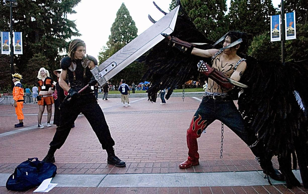 Chris Menges of Sequim,  left, plays Angeal from Final Fantasy 7: Crisis Core, squares off in cosplay with Eugene Cheng of Seattle, playing Devil Jin from the video game Tekken, during the 2007 Kumoricon in Vancouver.