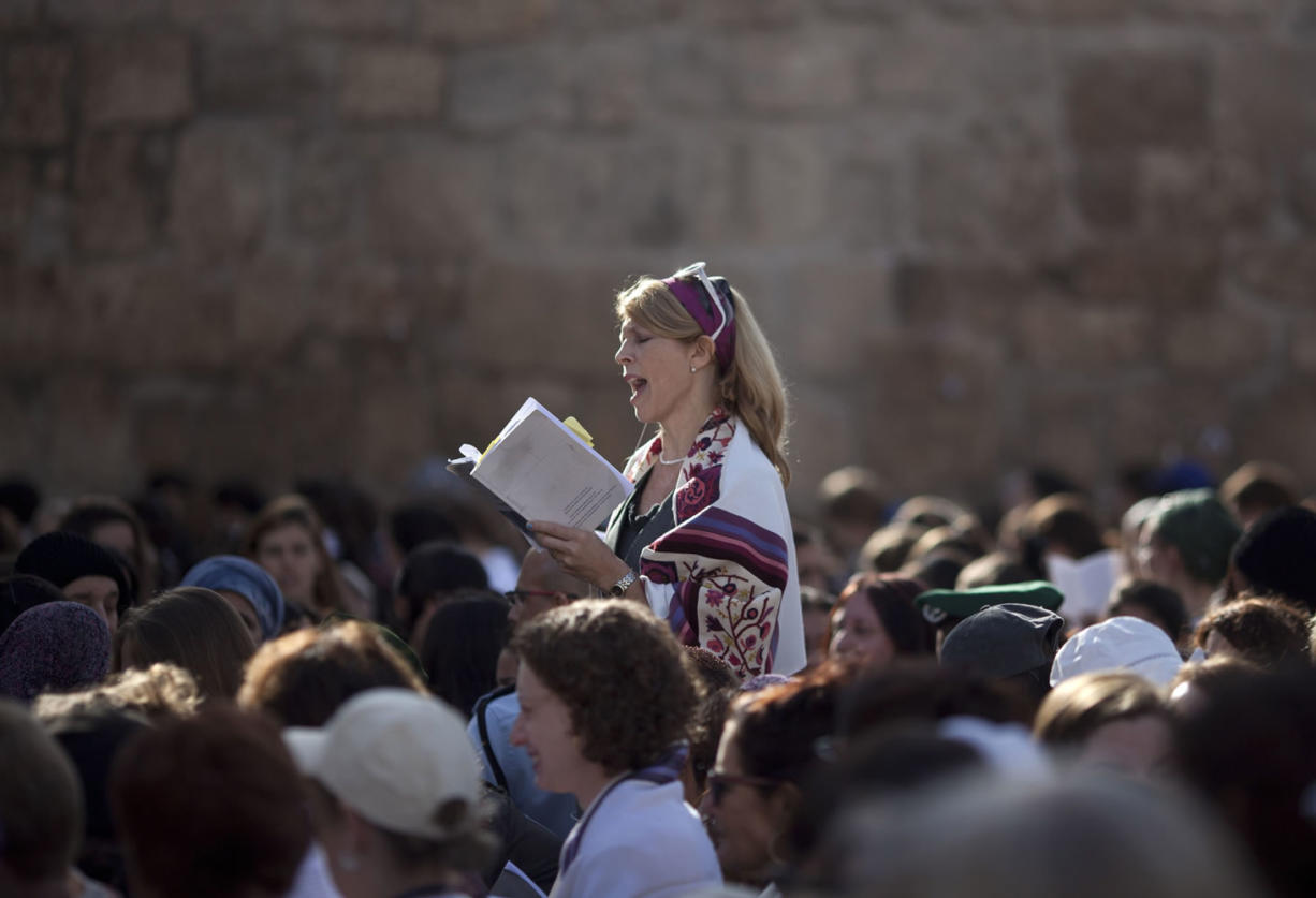 A Jewish woman prays at the Western Wall in Jerusalem's Old City. Israeli Prime Minister Benjamin Netanyahu is advancing a plan to allow non-Orthodox Jewish prayer at the Western Wall, a move advocates say would mark government support for liberal streams of Judaism. (Associated Press files)