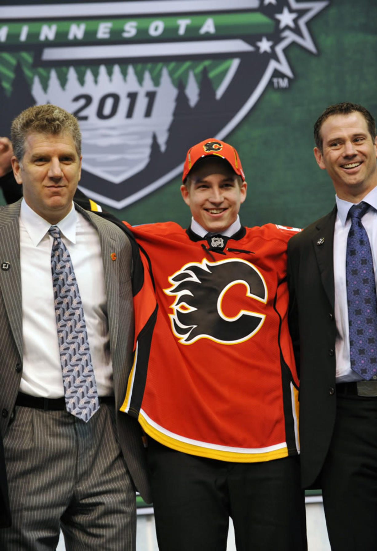 Portland Winterhawks' Sven Bartschi poses on stage after he was drafted in the first round by the Calgary Flames in the National Hockey League entry draft on Friday.