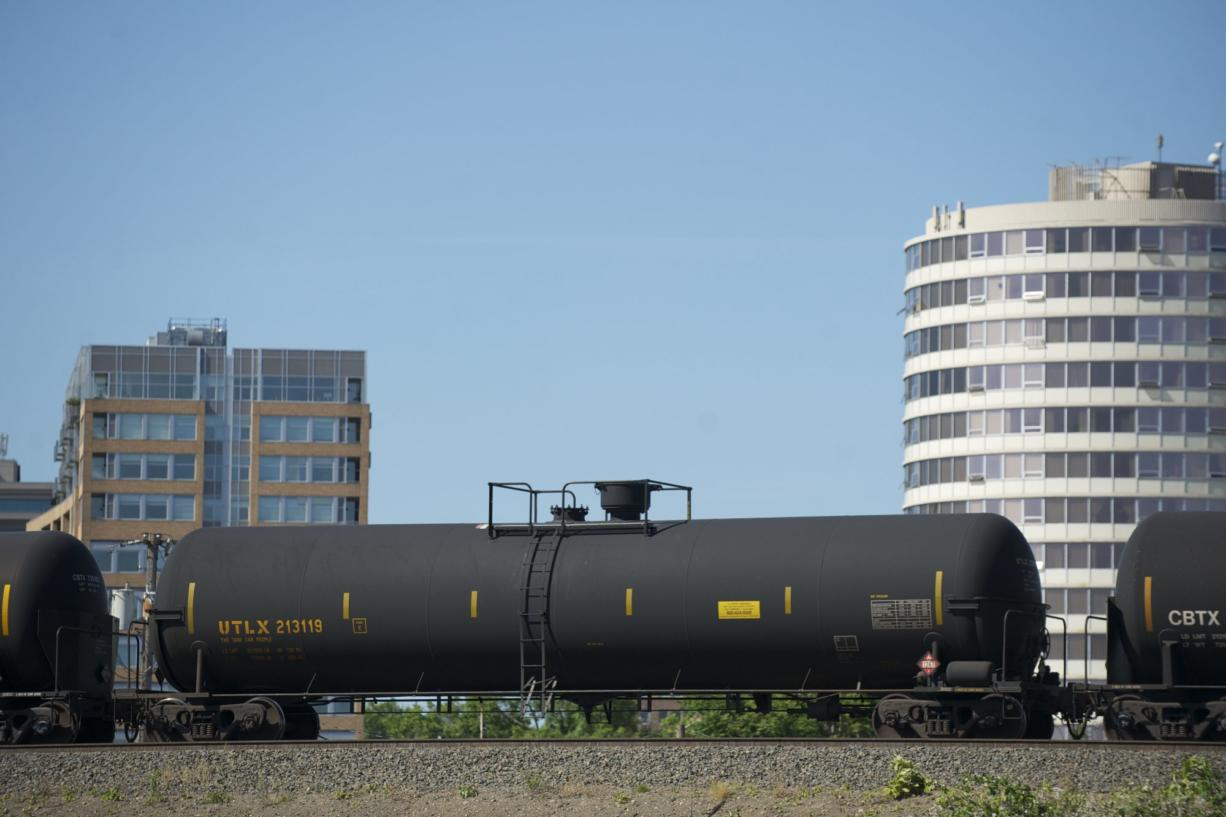 An oil train heads west through downtown Vancouver, near the Columbia Street overpass, in June 2014.